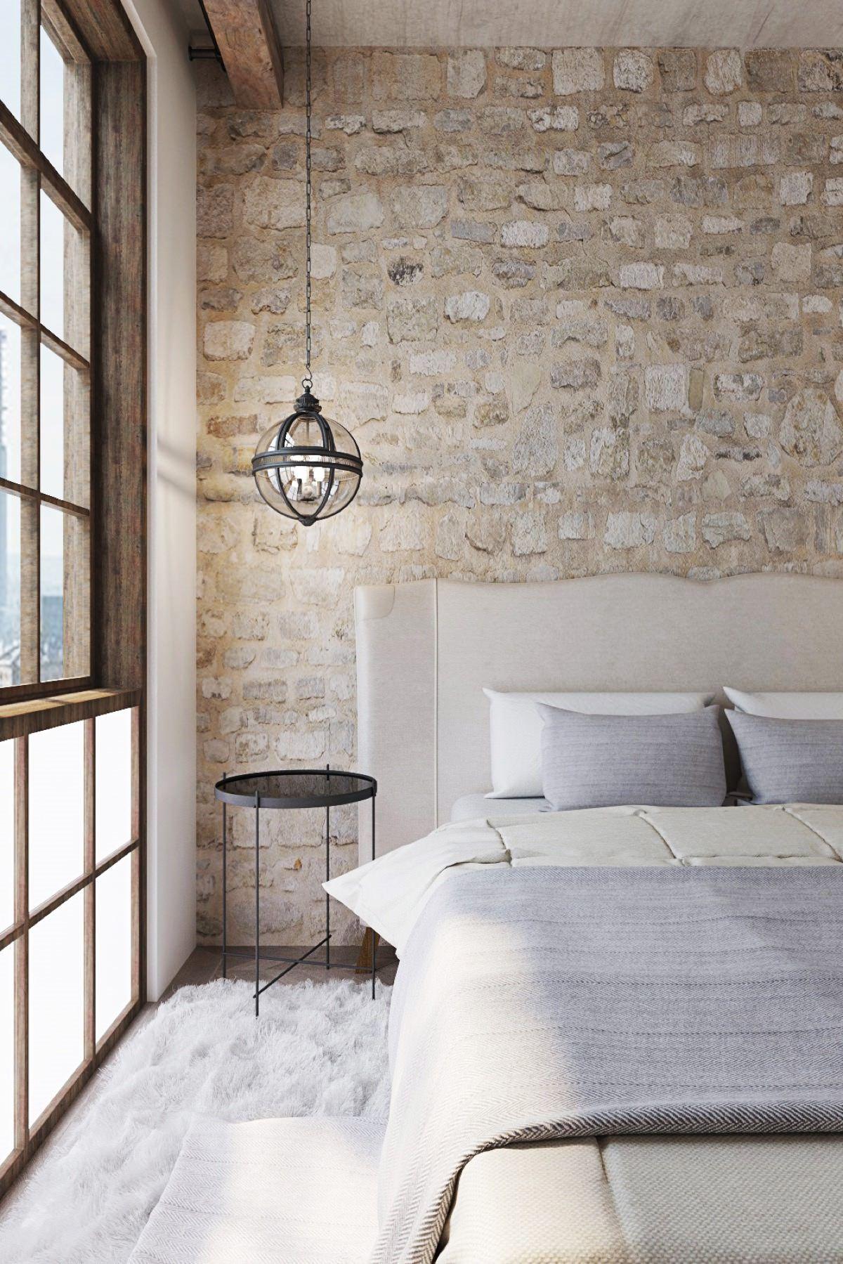 طراحی و دکوراسیون داخلی اتاق خواب شیک و ساده ای که از بافت سنگی به عنوان دیوار تاکیدی در آن استفاده شده است