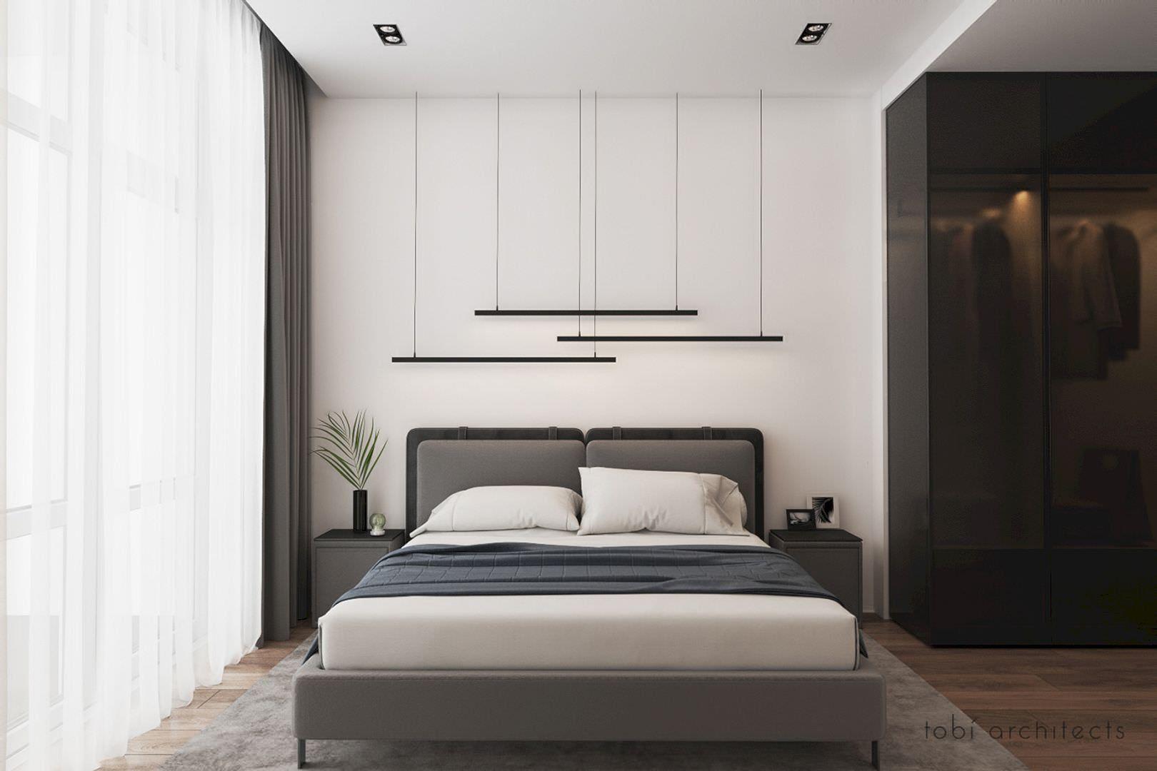 دکوارسیون اتاق خواب مدرن و ساده با تخت پارچه ای خاکستری که از تعادل نامتقارن در رنگ های تیره و روشن در آن استفاده شده است