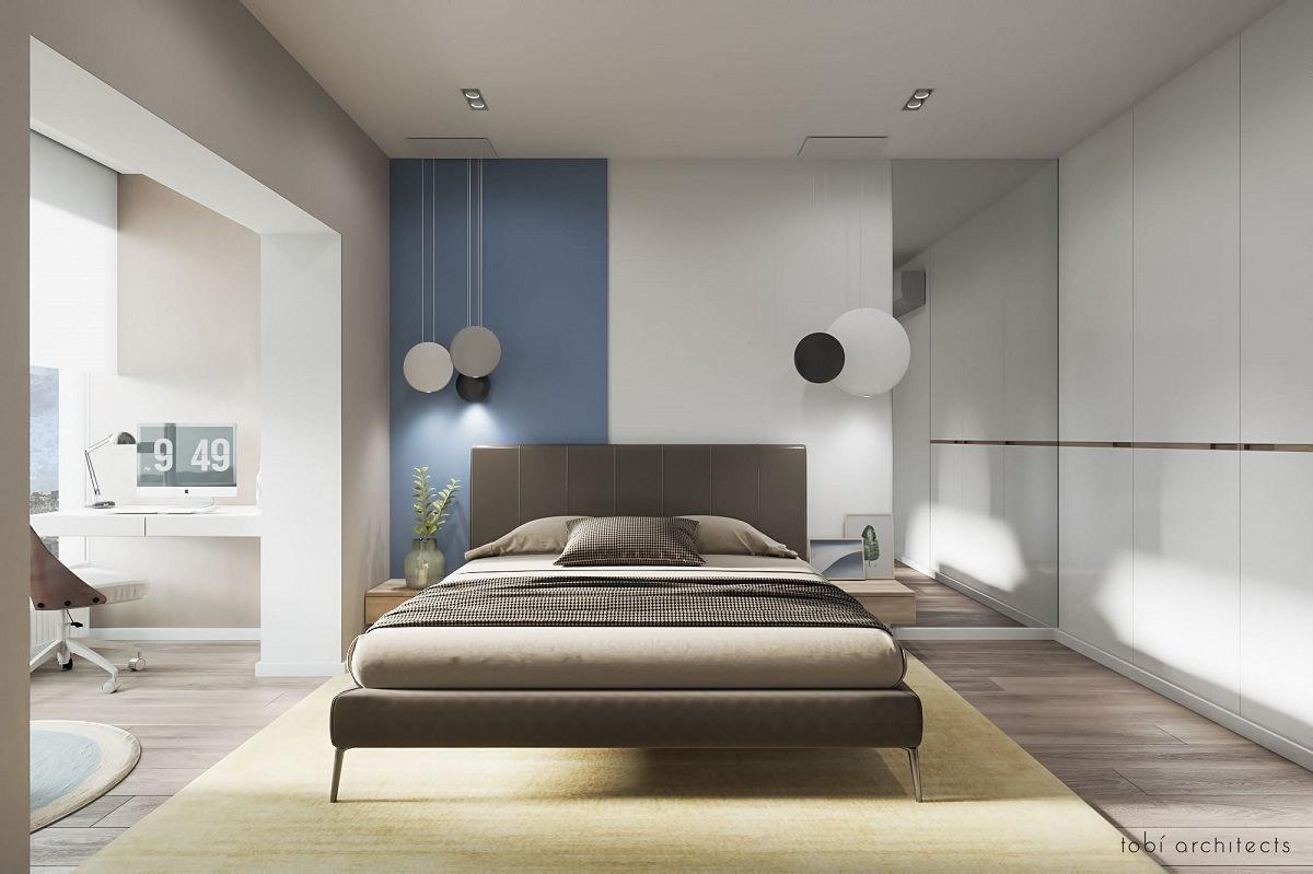 طراحی داخلی اتاق خواب مدرن با تخت پارچه ای قهوه ای که از تعادل نامتقارن در شکل های مستطیلی و گرد در آن استفاده شده است