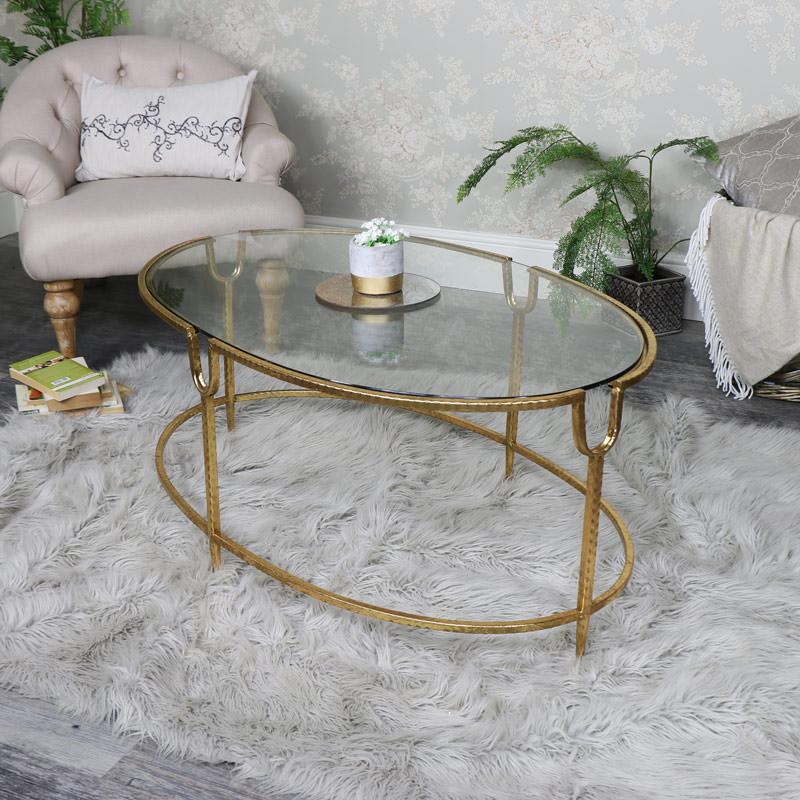 میز جلو مبلی شیشه ای پایه فلزی طلایی بیضی