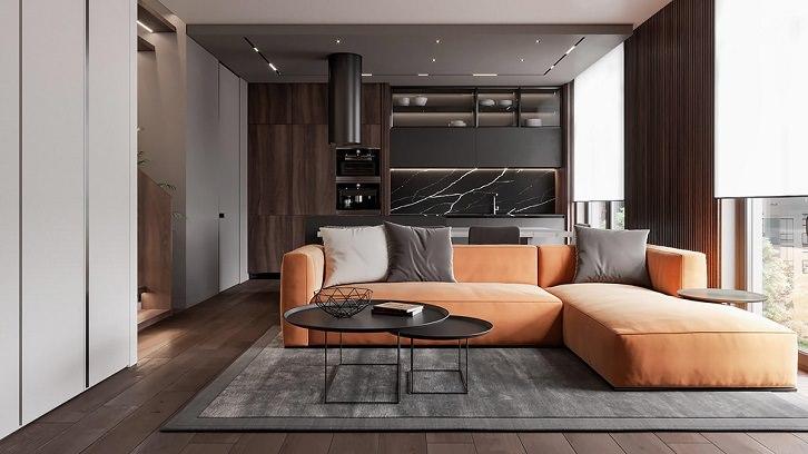 دکوراسیون نارنجی و قهوه ای نشیمن که مبل های نارنجی و کف و دیوارهای چوبی دارد