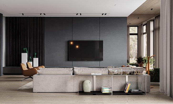 دکوراسیون خاکستری و طوسی نشیمن که در کنار دیوار تلویزیون خاکستری باقی مبلمان و دیوارها به رنگ های خنثی دیگر است