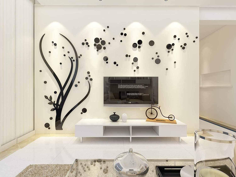 دیزاین دیوار پشت تلویزیون با استیکر دیواری مشکی طرح درخت