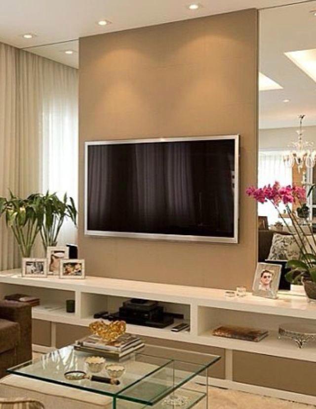 نقاشی دیوار پشت تلویزیون به رنگ قهوه ای روشن